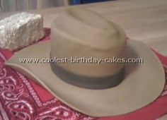 The brim is rolled fondant cut to fit over the brim of an overturned cowboy hat covered in wax paper and left to dry for two days.