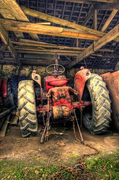 This is a very beautiful old tractor that is in this old barn!!!