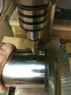 Start by drilling a hole near the top of the canister. Then on the oppostie side drill a hole. Smoke House Diy, Diy Smoker, Step Drill, Thing 1, Wood Fired Oven, Outdoor Kitchen Design, The Smoke, Kitchen Aid Mixer, Outdoor Cooking