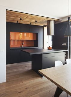 Joaquin Altamirano and Silvia Martín worked with Daniel Bergman Vázquez of Estudio Untercio to create an open-plan oasis in an apartment building in central Madrid. Estudio Untercio designed the medium-density fiberboard cupboards, which are coated with lacquer paintmatching the ceramic-porcelain countertops. The tubular hood above the island is by Teka.