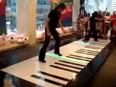 Phantom of the Opera, Bach Duo on a floor keyboard -- AMAZING!! Taking Chop Sticks to a whole new level:)