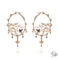 """""""Dream Catcher Hoop Earrings The Dream Catcher earrings have been created in gently textured 18ct rose gold and 5.30ct black and brown diamonds, accented with touches of black rhodium, form an image of the Tree of life, flowers and birds. According to Native Indians, a dream catcher will transform evil spirits and fears into pleasant dreams."""" (quote) By Annoushka €12,800"""