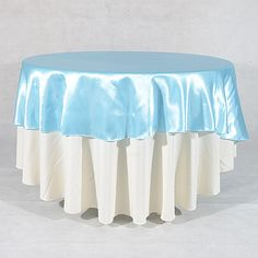Light blue satin round tablecloths by 108 inch. Available in 20 colors, shipping within 2-4 business days.