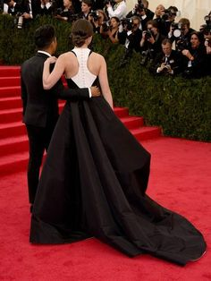 The buttoned-up back of Hailee's dress, with designer Prabal Gurung / http://racked.com/archives/2014/05/05/gowns-white-tie-gloves-all-the-looks-from-the-2014-metball.php