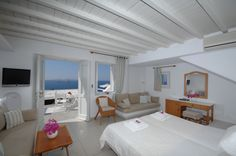 Here you can book directly from Mykonosview Hotel and have access to the best possible rates. Mykonos, Loft, Bed, Greece, Furniture, Home Decor, Image, Homemade Home Decor, Lofts