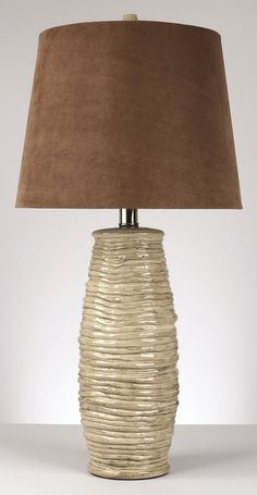 A set of two: Textured beige ceramic table lamps topped with brown micro fiber shades Beautiful textures Marvel on the unique clash of textures with the Haldis table lamps. Its ceramic base features a