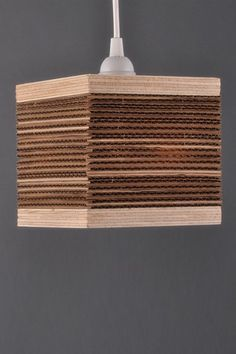 Corrugated Square Pendant Lamp -  by Shiner Lighting - handmade in Atlanta by a co who's goal is to transform landfill materials into eco chic.  Recycling, responsibly sourced woods - yes!!