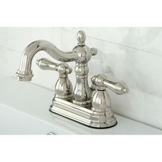 <li>Faucet type: Bathroom</li> <li>Number of handles: Double-handle</li> <li>Faucet finish: Polished nickel</li>