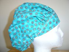 $10.99 This is a darling little hat done in a beautiful TURQUOISE. It has sweet flowers all over it done in YELLOW, PINK, PURPLE and GREEN....