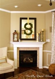 fireplace mantel with candles, lantern and pillar candleholders