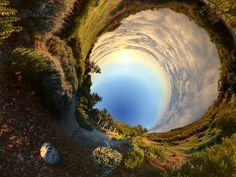 """""""In his Alternative Perspectives series, photographer and filmmaker Randy Scott Slavin creates surreal images of the world around him. He has figured out ways to distort a normal landscape into a magnificent swirl of circular patterns. The foundation of the landscape is always visible but he takes up to one hundred pictures to build the final, distorted scenes."""""""