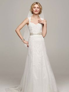 David's Bridal lace cap sleeve slim gown with keyhole back and heavily beaded sash. Wedding Dress Style VW9768.