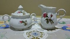 Vintage white sugar bowl and creamer with pink roses and gold trim