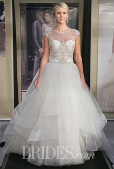 Brides.com: Fall 2014 Wedding Dress Trend: Illusion Cap Sleeves. Style B075, layered tulle ball gown wedding dress with a beaded satin bodice, illusion high neckline, and cap sleeves, Casablanca Bridal