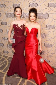 Red hot: Actress Vanessa and Laura Marano matched in red looks for the evening...