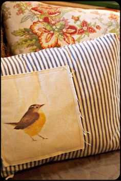 I love this pillow. the bird looks to be painted on muslin and then sewed to ticking. Perfect with the floral added