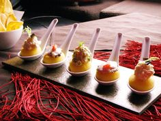 Mini causa bites: A Peruvian appetizer made with cold potato puree flavored with yellow aji chiles, molded into shapes and layered with seafood, chicken and avocado fillings.