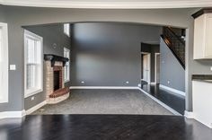 Dropped flooring in family room with carpet and dark hardwood surround in main traffic areas. Dark Hardwood, Old World Style, Amelia, Family Room, House Plans, Carpet, Rooms, Flooring, How To Plan