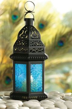 Blue Glass Moroccan Style Candle Lantern 37438 The cobalt hues of this exotic metal candle lantern bring to mind images of mysterious Morocco Moroccan Lanterns, Moroccan Decor, Moroccan Style, Moroccan Blue, Earthy Decor, Moroccan Bedroom, Moroccan Wedding, Lantern Centerpieces, Candle Lanterns