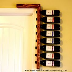 Wine Rack Ideas  I would change the holes so that the bottles were angled up slightly!