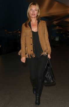 Oh, Kate — always pairing the unexpected. Here she sets the classic piece off with a fringed suede jacket. Photo courtesy of Saint Laurent