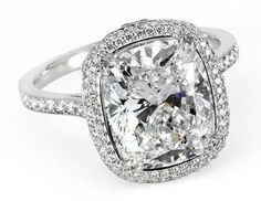 3ct cushion cut diamond in platinum with micropave waterfall halo setting.