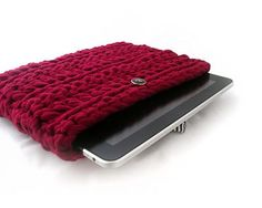 This is an iPad crochet sleeve knitted with fabric thread from recycled textile