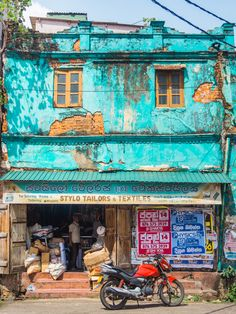 Old turquoise colonial building in Galle, Sri Lanka