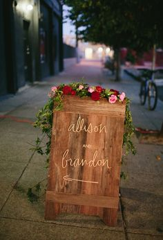 custom wood and flower sign | Photo by Jessica Burke