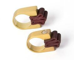 sterling silver rings that come with folded leather neatly locked into place by brass screws; Margherita (Ghita) Abi-Hanna
