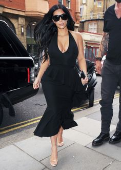 At four months pregnant, West stepped out in London looking ready to dance in a sassy Givenchy skirt, plunging body suit, and clear strap heels.