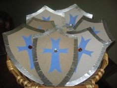 Shield Craft - uses cereal boxes - could paint if desired before adding decorative shapes.