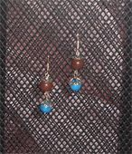 Imitation brown jasper and imitation Turkish turquoise. Silver bead caps and fish hook earring. Price: $6.00