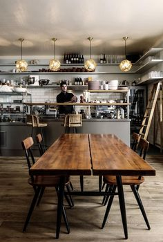 Simple communal table, white subway tile, deli lighting, metal countertops...Mogg and Melzer Joey at the deli counter