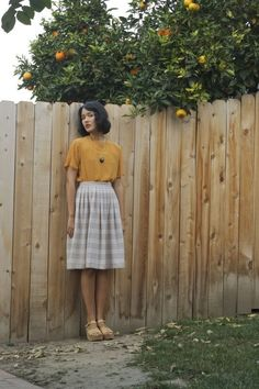 I love the striped skirt, nude hues. Very pretty.