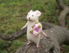 This little mouse is so cute and joyful. He holds a big bunch of flowers in his paw. Great present and home decor. The mouse and the bunch are handmade of pure wool using needle felt technique. The mouse has bendable arms, legs and tail, so he can be gently positioned how you imagine.