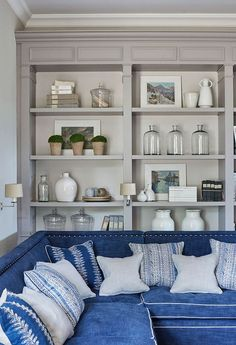 built-in book case with wonderful styling and a blue sectional - #graypaint