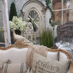 French Country Vignette at Vintage Market & Design #frenchmarket #vintagemarketanddesign #peacock #statuary #frenchlinen #paris