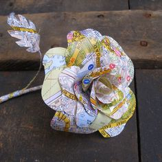 An elegant paper rose made from the pages of an old rescued London A-Z book. The rose stands approximately 28 cm high and 10 cm wide and has a flexible stem, so you can position it however you like. Each petal has been individually cut and attached, an. Z Book, Paper Roses, Buttonholes, Recycling, Elegant, My Style, London Calling, How To Make, Beautiful
