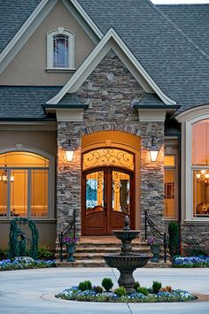 flatten arch and stone trim like this. Lanterns. NOTE the self-capped stone at right of entry. NOTE simple window and door trim - minus the keystone.