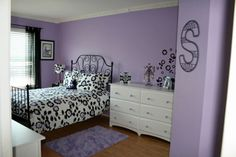 Wall color is called Wisteria by Sherwin Williams. I might try this in my craft room. (Oct12)