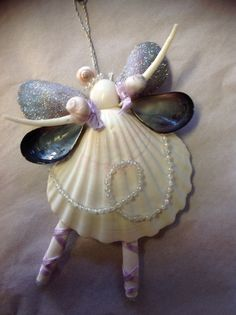 Handmade Nutcracker Sweet Ballerina Seashell Angels are so fun Dancing. Each Angel has a Large White Scalloped Seashell. Arms are Dentalium (a kind of worm Shell), Her face is a white moon snail. The Angels have movable arms Seashell Ornaments, Seashell Art, Seashell Crafts, Beach Crafts, Fun Crafts, Diy And Crafts, Crafts For Kids, Arts And Crafts, Angel Ornaments
