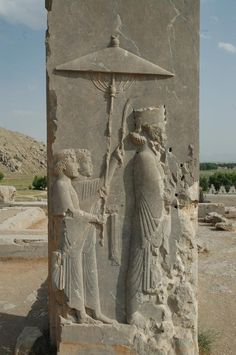 Relief of the Persian king Xerxes (485-465 BCE) in the doorway of his palace at Persepolis, modern-day Iran. The bearers of the parasol and the towel-and flywhisk symbolize the royalty and power of the monarch.    Photo courtesy and taken by Jona Lendering, via the Wiki Commons