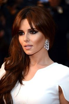Gorgeous Cheryl Cole with dark smokey eyes and nude lips makeup look.