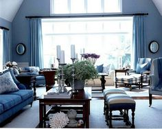 Interior: White And Blue Living Room Design With Blue Sofa And Wood Coffe Table Also Pouffe And Arm Chair Also Glass Window With Blue Chusion: Best White and Blue Interior Decorating Design ideas
