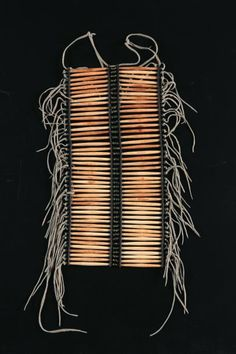 Breastplate (Pectoral) ~ Sioux, Plains. Early 20th century. Deer bone beads, leather and brass bead tassels