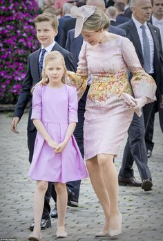 Queen Mathilde played the doting mother as she tended to a chic looking Princess Eleonore