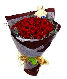 Let her know what's in your heart with this stunning floral expression of love where 33 red Roses come together with a lovely bear¡to sweep her off her feet and into your heart. (Bear may vary)