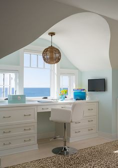 Beach style home office with an ocean view [Design: George Penniman Architects]