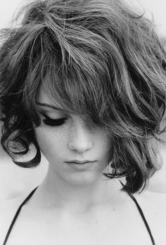 """""""This tousled, bed-head bob is great for frizzy hair,"""" says Philip B. """"The extra texture lends it volume and interest."""" Plus, he says wavy bobs are flattering for the face and low-maintenance -- double points for busy women."""